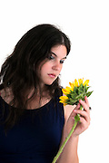 young female teen with sunflower