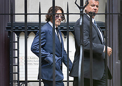 © Licensed to London News Pictures. 07/07/2020. London, UK. US actor Johnny Depp (L) is seen at The High Court in Central London during a break in proceedings. Johnny Depp's libel trial against The Sun newspaper is due to take place over the next three weeks over allegations he was violent and abusive towards his ex-wife Amber Heard. Photo credit: Peter Macdiarmid/LNP