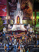 18 FEBRUARY 2016 - BANGKOK, THAILAND:  People at the Trimurti Shrine in Bangkok after the weekly Thursday night prayer. Every Thursday night, starting just after sunset and peaking at 21.30, hundreds of Bangkok single people, or couples seeking guidance and validation, come to the Trimurti Shrine at the northeast corner of Central World, a large Bangkok shopping mall, to pray to Lord Trimurti, who represents the trinity of Hindu gods - Brahma, Vishnu and Shiva. Worshippers normally bring an offering of red flowers, fruits, one red candle and nine incense sticks. It's believed that Lord Trimurti descends from the heavens at 21.30 on Thursday to listen to people's prayers. Although most Thais are Buddhists, several Hindu traditions have been incorporated into modern Thai Buddhism, including reverance for Trimurti.      PHOTO BY JACK KURTZ