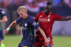 July 25, 2018 - East Rutherford, NJ, U.S. - EAST RUTHERFORD, NJ - JULY 25:  Manchester City midfielder Oleksandr Zinchenko (35) battles Liverpool forward Sadio Mane (10) during the second half of the International Champions Cup Soccer game between Liverpool and Manchester City on July 25, 2018 at Met Life Stadium in East Rutherford, NJ.  (Photo by Rich Graessle/Icon Sportswire) (Credit Image: © Rich Graessle/Icon SMI via ZUMA Press)