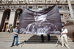 June 1, 2017 - Kiev, Ukraine - Protesters hold a portrait of military leader and general of the Ukrainian Insurgent Army (UPA) Roman Shukhevych. Activists and veterans of volunteering battalions rally in front of Kyiv city council demanding to official recognition of volunteers as a war veterans, Kyiv, Ukraine, June 1, 2017. (Credit Image: © Sergii Kharchenko/NurPhoto via ZUMA Press)