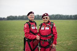 © Licensed to London News Pictures. 25/08/2016. <br /> <br /> Pictured: From left to right, Fred Glover and Ted Pieri, two D-Day veterans who are both 90 years old shake hands after having parachuted into Sarum Airfield, Wiltshire on Thursday 25th August 2016, 72 years after D-Day having earlier in the month parachuted into Merville Battery in France.<br /> <br /> Photo credit should read Max Bryan/LNP