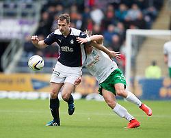 Falkirk's David McCracken and Hibernian's Jason Cummings. <br /> Falkirk 0 v 3 Hibernian, Scottish Championship game played at The Falkirk Stadium 2/5/2015.