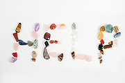 New age crystals and gemstones spelling out Help