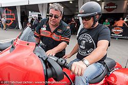 Harley-Davidson's Vinny Dorazio helps a rider before a test ride of a new 2017 Harley-Davidson Milwaukee Eight during Daytona Beach Bike Week. FL. USA. Sunday March 12, 2017. Photography ©2017 Michael Lichter.