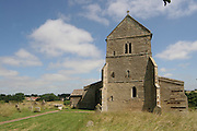 Wadenhoe village in Northamptonshire featuring a medevial church on a hill abovethe village