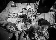 Five of the 6 children of Glauce that  lives in a shelter of eight square meters with her six children - and mom in the Copa do Povo (People's Cup) Camp in Itaquera, São Paulo. The Copa do Povo Camp, is just a few miles from the Arena Corinthians and has 5,000 homeless workers and their families occupied area of fifteen acres. They are homeless after rents skyrocketed because of the World Cup. (Eduardo Leal).