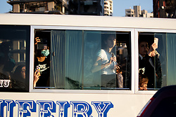© Licensed to London News Pictures. 16/08/2020. Beirut, Lebanon. A group of people in a bus take photos of the blast site in Beirut Port following the huge explosion on 4 August. Photo credit : Tom Nicholson/LNP