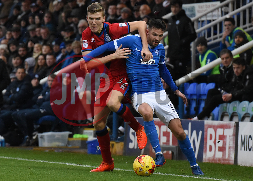 Mark Kitching of Rochdale and Bradden Inman of Peterborough United battle to keep the ball over the line - Mandatory by-line: Chantelle McDonald/JMP - 25/02/2017 - FOOTBALL - ABAX Stadium - Peterborough, England - Peterborough United v Rochdale - Sky Bet League One