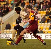 Photo: Jed Wee.<br /> Bradford City v Bristol City. Coca Cola League 1. 18/02/2006.<br /> <br /> Bristol's Mark McCammon (L) holds off Bradford's David Wetherall.