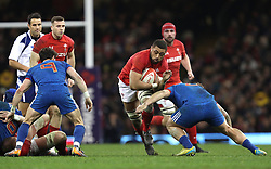 Wales' Taulupe Faletau (left) is tackled by Frances' Marco Tauleigne (right) during the NatWest 6 Nations match at the Principality Stadium, Cardiff.
