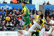 Norwich's Timm Klose (17) just misses a cross as players tussle at a corner. Barclays Premier league match, Swansea city v Norwich city at the Liberty Stadium in Swansea, South Wales on Saturday 5th March 2016.<br /> pic by  Carl Robertson, Andrew Orchard sports photography.
