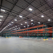 Interior of Kendall Jackson Distribution Warehouse. This 600k sq foot facilty must maintain 57 F degrees to keep the wine from not going bad. Industrial Infrastructure- Architectural Photography Example of Chip Allen's work.