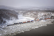 Under a blustery snow, a southbound intermodal train exits Fort Montgomery tunnel and crosses ice filled Popolopen Creek. During the revolution, the Continental Army built forts on both sides of the creek inlet, which formed the main southern defenses of the Hudson River in an attempt to deny the corridor to the British. In later days, this important transportation corridor would yield to the railroad, which built on both shores from New York City up to Albany and became the great New York Central System. CSX now operates this line and it sees a great deal of traffic as illustrated by hot intermodal, Q118, on it's way to Croxton, NJ from Chicago on a wintery January 12, 2011.