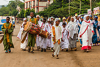 A group of Ethiopian Orthodox Christians marching down the road during the Meskel religious holiday, Arba Minch, Ethiopia.