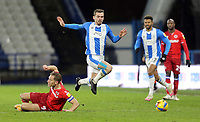 Huddersfield Town's Harry Toffolo skips over the challenge from Reading's Michael Morrison<br /> <br /> Photographer Rich Linley/CameraSport<br /> <br /> The EFL Sky Bet Championship - Saturday 2nd January 2021 - Huddersfield Town v Reading - The John Smith's Stadium - Huddersfield<br /> <br /> World Copyright © 2020 CameraSport. All rights reserved. 43 Linden Ave. Countesthorpe. Leicester. England. LE8 5PG - Tel: +44 (0) 116 277 4147 - admin@camerasport.com - www.camerasport.com