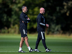 CARDIFF, WALES - Monday, August 31, 2020: Wales' manager Ryan Giggs (L) and Robert Page watch an Under-21 training session at the Vale Resort ahead of the UEFA Under-21 Championship Qualifying Round Group 9 match between Bosnia and Herzegovina and Wales. (Pic by David Rawcliffe/Propaganda)