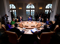 Prime Minister Justin Trudeau, clockwise from middle back, sits with President of France Emmanuel Macron, Japan Prime Minister Shinzo Abe, Italian Prime Minister Giuseppe Conte, President of the European Commission, Jean-Claude Juncker, President of the European Council, Donald Tusk, British Prime Minister Theresa May, German Chancellor Angela Merkel, and U.S. President Donald Trump as they take part in the G7 Working Session I at the G7 Leaders Summit in La Malbaie, Quebec, Canada, on June 8, 2018. Photo by Sean Kilpatrick/CP/ABACAPRESS.COM