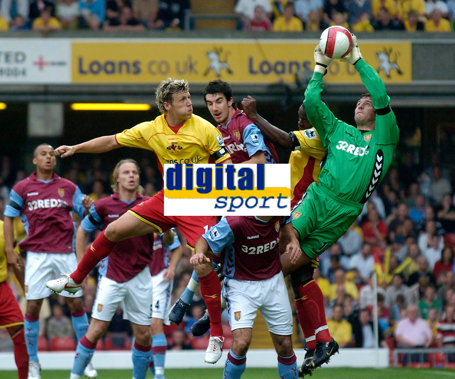 Photo: Richard Lane.<br />Watford v Aston Villa. The Barclays Premiership. 16/09/2006. <br />Villa's Thomas Sorenson catches the ball from Darius Henderson's header.