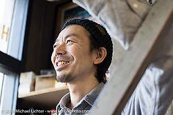 Hideya Togashi at his Hide Motorcycles custom motorcycle shop in Kawasaki, Japan after the Yokohama Hot Rod & Custom Show. Kawasaki, Japan. December 6, 2016.  Photography ©2016 Michael Lichter.