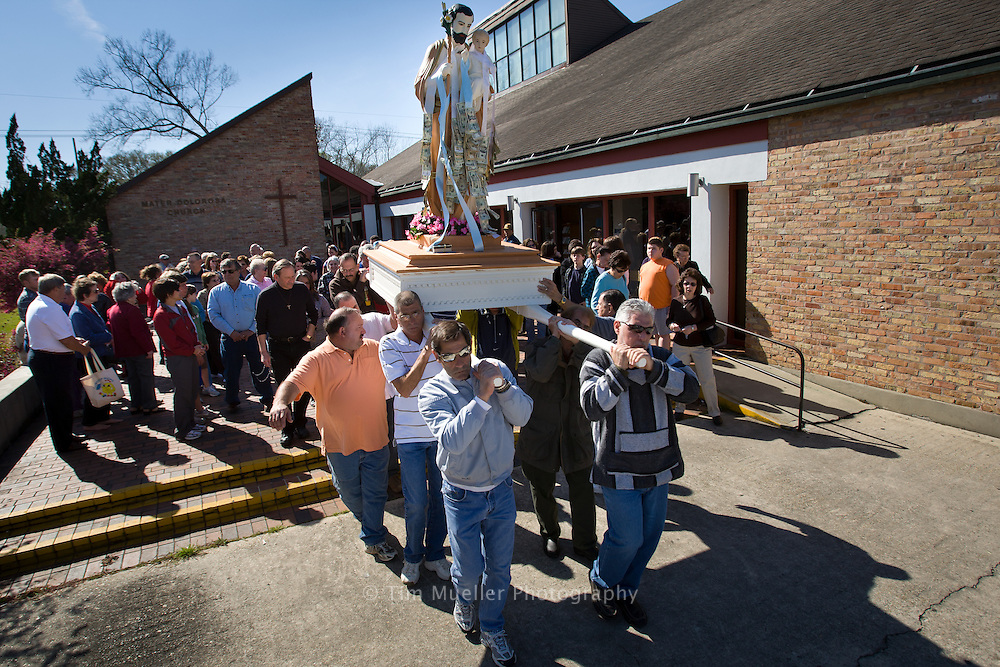 St. Joseph Society members carry the statue of St. Joseph through the town of Independence, La. Aside from family gatherings, Mater Dolorosa Catholic Church is the primary place where Italian families gather in Independence.