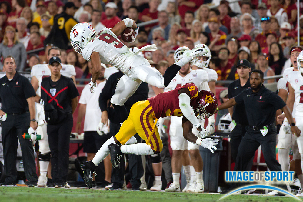 Stanford Cardinal wide receiver Osiris St. Brown (9) attempts to hurdle Southern California Trojans cornerback Greg Johnson (9) during a NCAA college football game. Southern California Trojans defeated the Stanford Cardinal 45-20 on Saturday, Sept. 7, 2019, in Los Angeles. (Ed Ruvalcaba/Image of Sport)