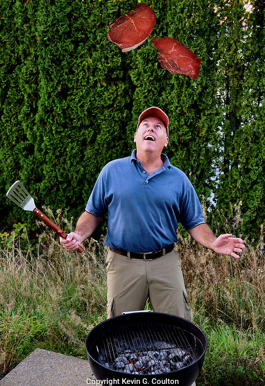 """Humorous photograph of a man at a barbecue looking up a two steaks floating high above his head visually depicting the saying """"The steaks (stakes) are high!"""""""