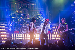 The band Hairball performs at the Harley-Davidson kick off party at Dirty Harry's Bar on Main Street during Daytona Bike Week. Daytona Beach, FL. USA. Monday March 13, 2017. Photography ©2017 Michael Lichter.