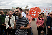 James from London Leap speaks at the Rise For Climate Change event held outside Tate Modern in London, England, United Kingdom on September 8th 2018. Tens of thousands of people joined over 830 actions in 91 countries under the banner of Rise for Climate to demonstrate the urgency of the climate crisis. Communities around the world shined a spotlight on the increasing impacts they are experiencing and demanded local action to keep fossil fuels in the ground. There were hundreds of creative events and actions that challenged fossil fuels and called for a swift and just transition to 100% renewable energy for all. Event organizers emphasized community-led solutions, starting in places most impacted by pollution and climate change. Photographed for 350.org.