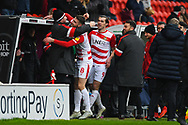 Ben Whiteman of Doncaster Rovers (8) scores a goal and celebrates to make the score 1-0, dedicating the goal to and celebrating with Paul Gerrard for his recent work away from match days, during the EFL Sky Bet League 1 match between Doncaster Rovers and Scunthorpe United at the Keepmoat Stadium, Doncaster, England on 15 December 2018.