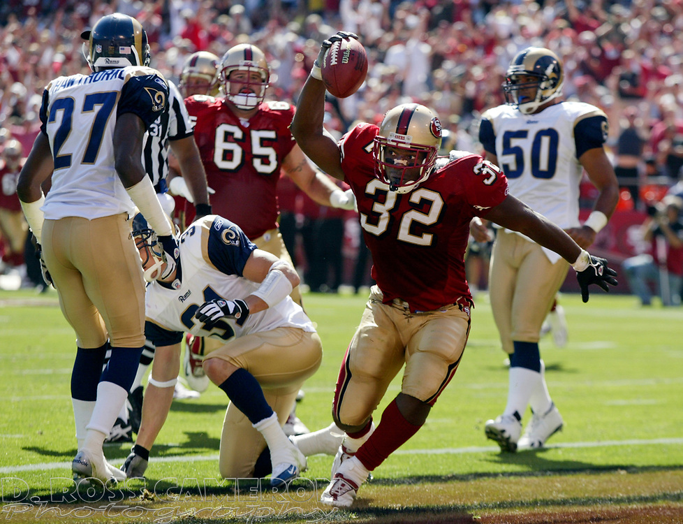 San Francisco 49ers running back Kevan Barlow (32) celebrates his touchdown against the St. Louis Rams in the third quarter of an NFL football game, Sunday, Sept. 11, 2005 at Candlestick Park in San Francisco. The 49ers won their regular season opener, 28-25. (D. Ross Cameron/the Oakland Tribune)