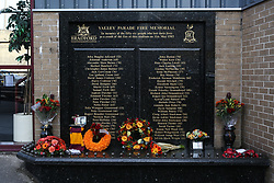 © Licensed to London News Pictures. 11/05/2017. Bradford, UK. The Bradford City fire memorial at Valley Parade football ground. A ceremony is held in Bradford today to commemorate the 32nd anniversary of the Bradford City fire. The Bradford City fire happened on 11th May 1985 during a game between Bradford City and Lincoln City. The disaster killed 56 and injured at least 265 people. Photo credit : Ian Hinchliffe/LNP