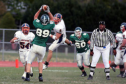 10 November 2007: Rick Podkowa pulls in a pass in the middle of the field and turns to run. This game between the Wheaton College Thunder and the Illinois Wesleyan University Titans was for a share of the CCIW Championship and was played at Wilder Field on the campus of Illinois Wesleyan University in Bloomington Illinois.