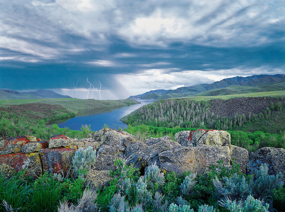 Edition of 65 includes all sizes<br /> Lightening Storm rolls through the lava fields of south central Idaho near Carey, Idaho with the Little Wood Reservoir in foreground