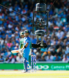 The obtrusive Spider Cam TV camera, low over the pitch