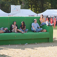 Participants sit on giant furnitures in their pasttime during Sziget festival held in Budapest, Hungary on August 10, 2011. ATTILA VOLGYI