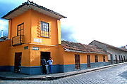 ECUADOR, HIGHLANDS, CUENCA colonial architecture; cobblestone st.