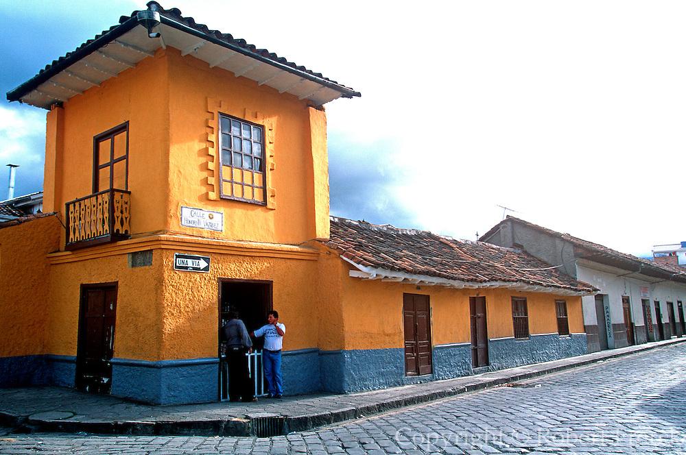 ECUADOR, HIGHLANDS, CUENCA colonial architecture; cobblestone st.