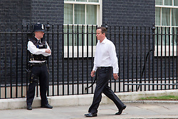 © Licensed to London News Pictures. 16/07/2013. London, UK. The British Prime Minister, David Cameron, looks relaxed as he walks in Downing Street after dropping off his youngest daughter, Florence, at daycare in London today (16/07/2013). Photo credit: Matt Cetti-Roberts/LNP