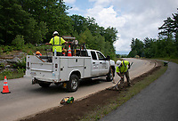 Mirra Utility Contractors crew Kevin Arriel,  Frank Smith, David Webber and Nyk Komm cleanup after the installation of underground conduit for Comcast Cable Communications at Turner Way in Laconia on Wednesday.  (Karen Bobotas/for the Laconia Daily Sun)