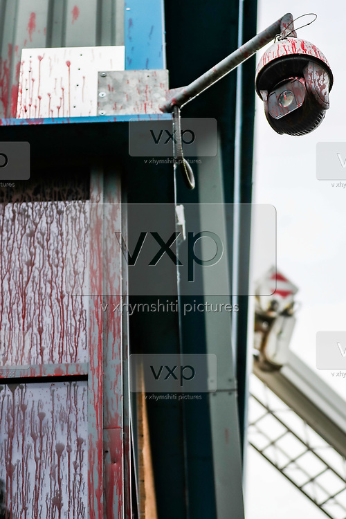 """Leicester, United Kingdom, May 20, 2021: A view of security cameras after activists of """"Palestine Action"""" poured red colour on the entrance side of the Elbit subsidiary UAV Tactical Systems during a """"Stop Bombing Gaza"""" protest campaign in Leicester on Thursday, May 20, 2021. <br /> UK based Pro-Palestinian activists' group """"Palestine Action"""" who seized control of the Leicester based factory of Elbit subsidiary UAV Tactical Systems on Wednesday, continue to occupy its rooftop for the 2nd day with activists saying that """"the occupation is aiming to be as disruptive as possible; these activists are determined to prevent Elbit from resuming its business of bloodshed."""" A dozen people waving Palestinian flags and """"STOP BOMBING GAZA"""" placards have gathered outside the factory in support of activists standing on the rooftop. (Photo by Vudi Xhymshiti/VXP)"""