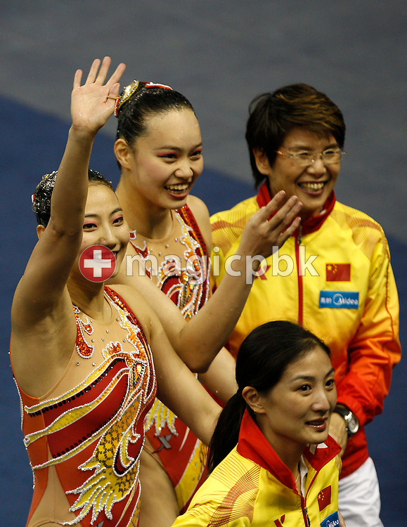 Silver medalist Xuechen Huang and Ou Liu of China celebrate with their coaches after competing in the Synchronized (synchronised) Swimming Technical Duets Final round during the 14th FINA World Aquatics Championships at the Oriental Sports Center in Shanghai, China, Monday, July 18, 2011. (Photo by Patrick B. Kraemer / MAGICPBK)
