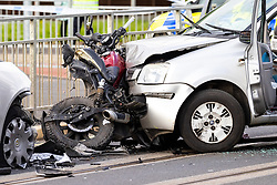 © Licensed to London News Pictures. 26/05/2021. Wythenshawe, UK. The wreckage of a motorbike is seen sandwiched between two cars at the scene of an RTA on Hollyhedge Road in Benhill , South Manchester . The road is closed to all traffic and trams . Photo credit: Joel Goodman/LNP