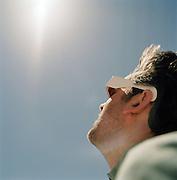 Tourist watching the 2006 Eclipse in the Sahara Desert, Libya