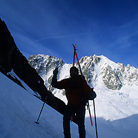 SKIING,French Alps, Haute Route skiers(MR) climb Chardonnet Glacier. Aiguille Verte (4121m) bkg.