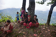 Women gathered at a meeting held by community leaders. The Chepangs is an ethnic group which used to be nomadic. Only recently have the settled and their settlements are high up in the mountains. Only a few years ago they did not have any running water and had to bring up water from below but with the help pf Restless Development and their partner NGO Prayash Nepal they now have running clean water from springs diverted into resovoirs and the connected to taps inther settlement. This not only give them clean water to drink, it also improve hygiene dramatiaclly and improve health and it saves precious time for the women who now spend the 4 hours it used to take getting water growing healhty vegetables.