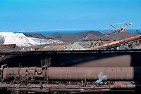 ©Tom Wagner 2004<br /> Pipes and slag heaps - view of Tokyo Bay; Japan.<br /> Japan. Industry. Steel.