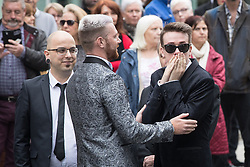 © Licensed to London News Pictures . 30/06/2017 . Stockport , UK . Family and friends arrive outside the Town Hall . The funeral of Martyn Hett at Stockport Town Hall . Martyn Hett was 29 years old when he was one of 22 people killed on 22 May 2017 in a murderous terrorist bombing committed by Salman Abedi, after an Ariana Grande concert at the Manchester Arena . Photo credit : Joel Goodman/LNP