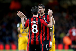 AFC Bournemouth's Charlie Daniels and AFC Bournemouth's Harry Arter celebrat after the final whistle