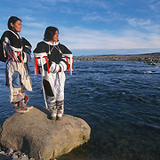Inuit women in native dress called amautiq. Baker Lake, Canada
